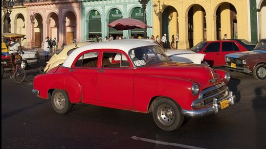 Pre-1960 American car on the historic Prado Avenue in Havana