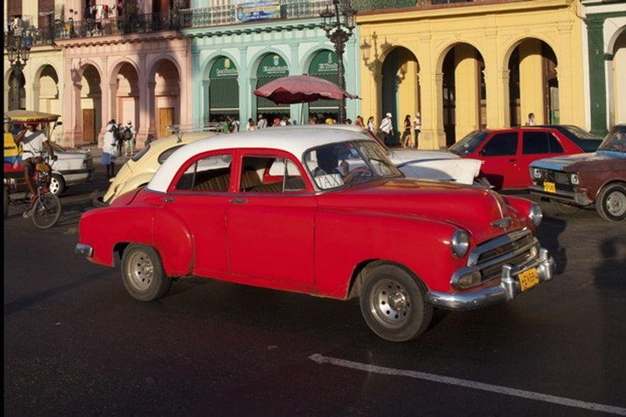 Pre-1960 American car on the historic Prado Avenue in Havana