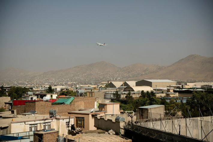 A plane from Turkish Airlines takes off from Hamid Karzai International Airport on August 15, 2021. ...