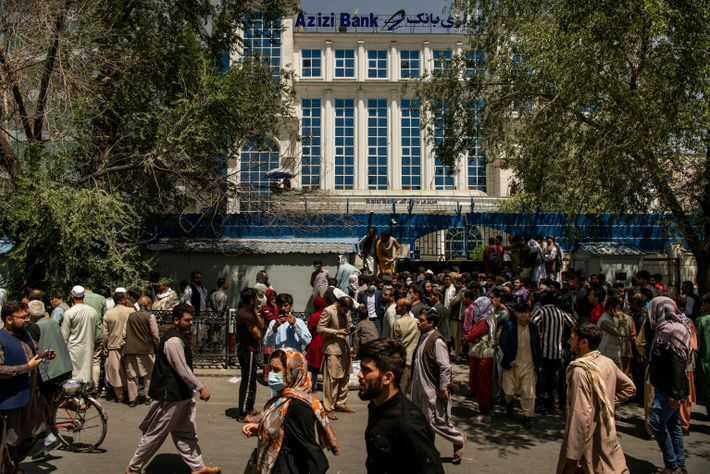 On August 15, 2021, people gather in front of Azizi Bank in Shahre Now to withdraw ...