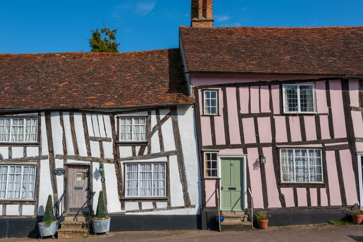 Crooked timbered houses in Lavenham, a historic wool town in Suffolk, on the edge of Dedham ...