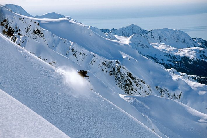 A backcountry skier barrels down the ridge of Alaska's Resurrection Peninsula.
