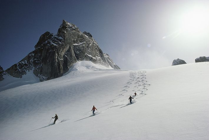 Skiers descend Vowel Glacier in British Columbia's Bugaboo ski area.