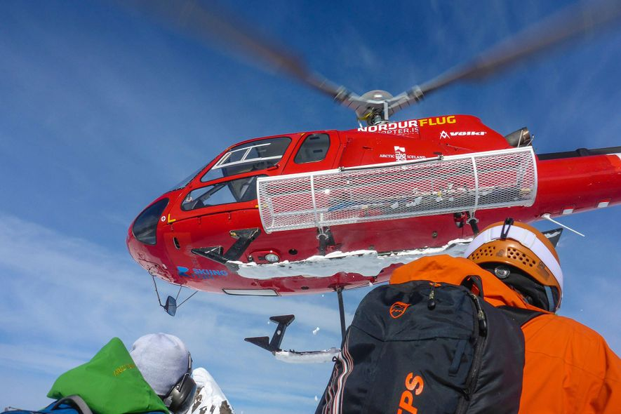 A helicopter takes off after dropping skiers at Iceland's Troll Peninsula.