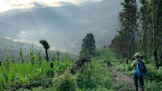 The trail descends into the sun-filled bowl of the Jiri River valley, the remote border between ...