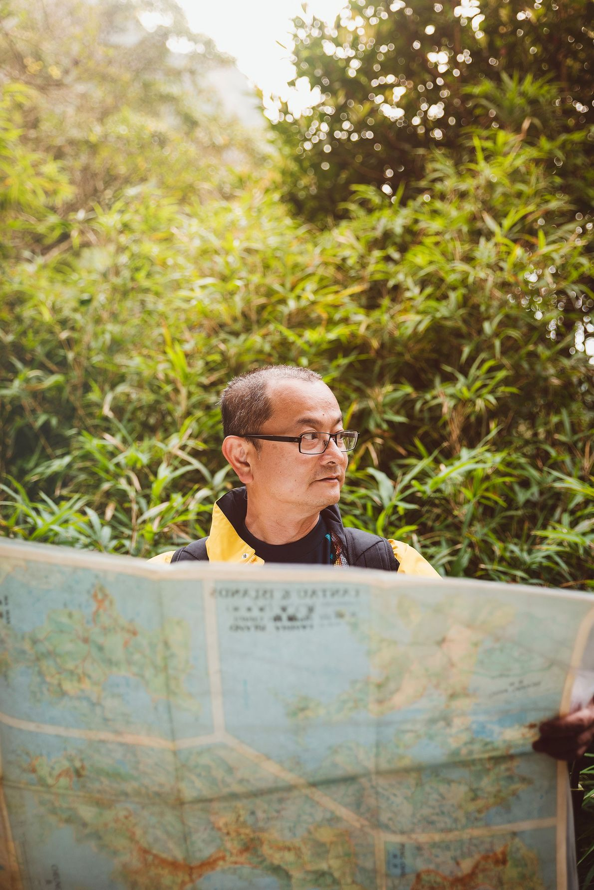 Hiking guide Roy consults a map of Lantau Island, Hong Kong's largest.