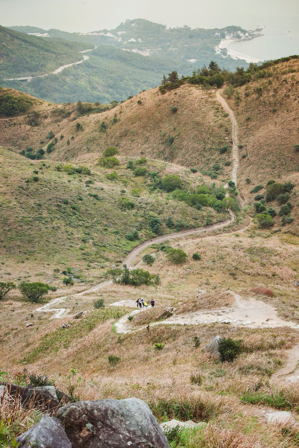 A group of young hikers trek to Lantau Peak, Lantau Island. Up until the mid-1800s, the ...