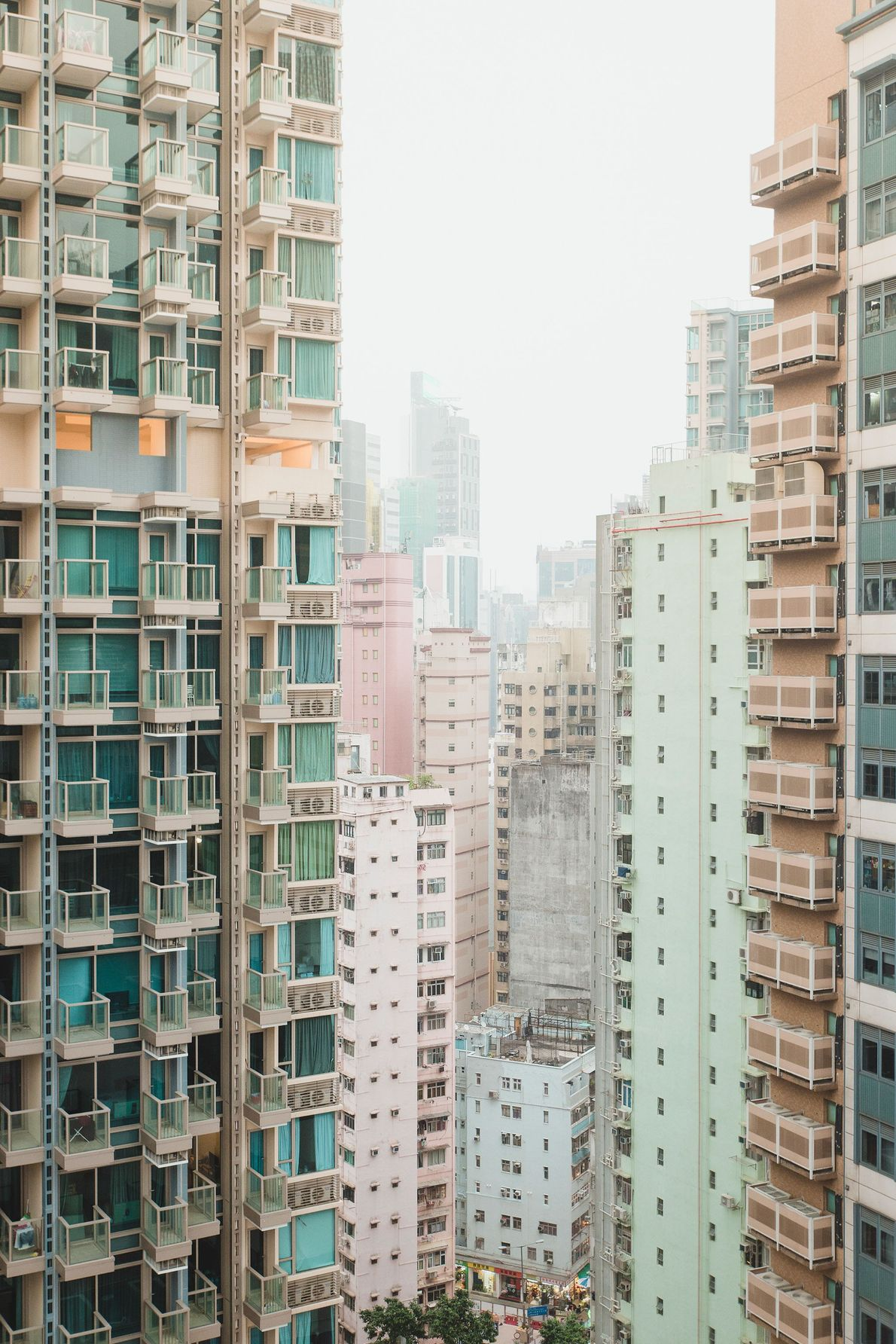 High-rise apartments form a street canyon on Hong Kong Island. Housing is at such a premium ...