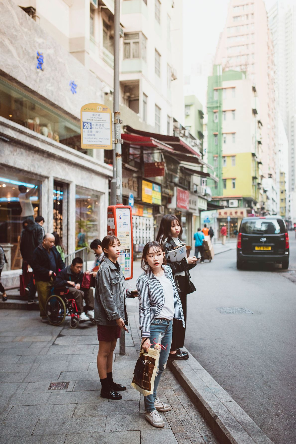 Teenagers hang out on Hong Kong Island. With limited public space, locals often choose between spending ...