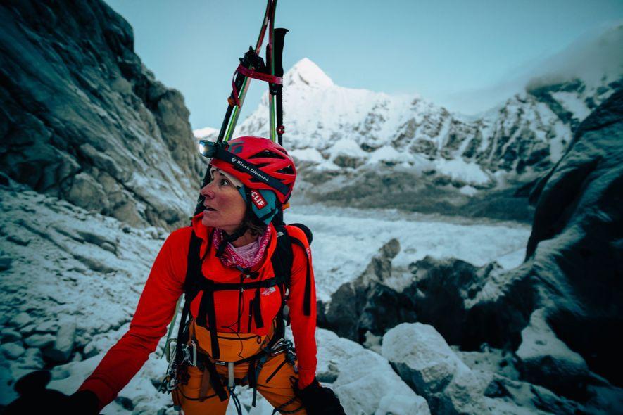 Nelson slowly climbs, amid heavy rock fall, through the Khumbu Icefall.