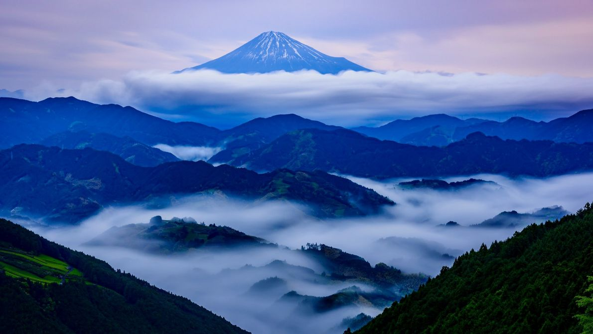 For this image, Nakazawa waited through hours of heavy rains and thick fog until a clearing ...
