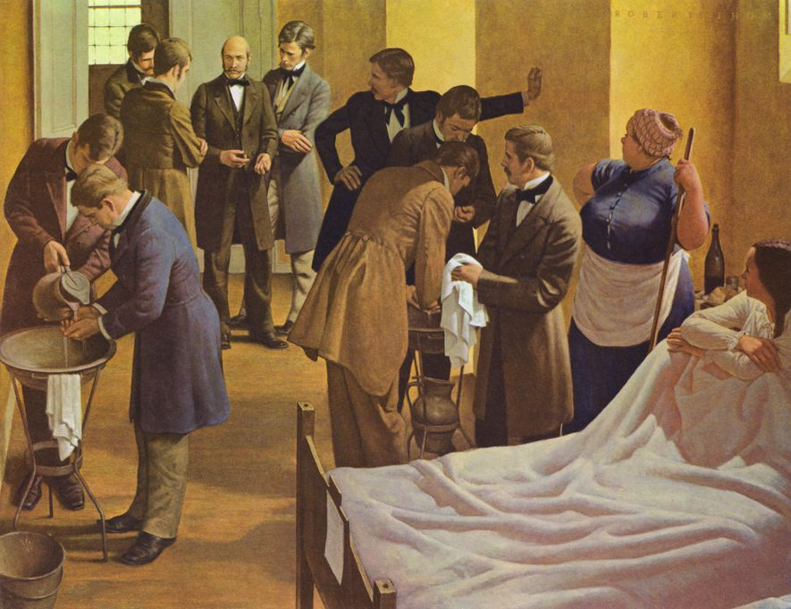 Painter Robert Thom depicts Semmelweis (centre) in the Vienna General Hospital in Austria overseeing doctors washing ...