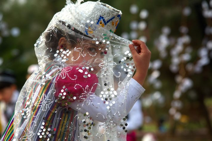 A girl dressed in traditional clothing during 'Navruz' celebrations in Khujand, Tajikistan.