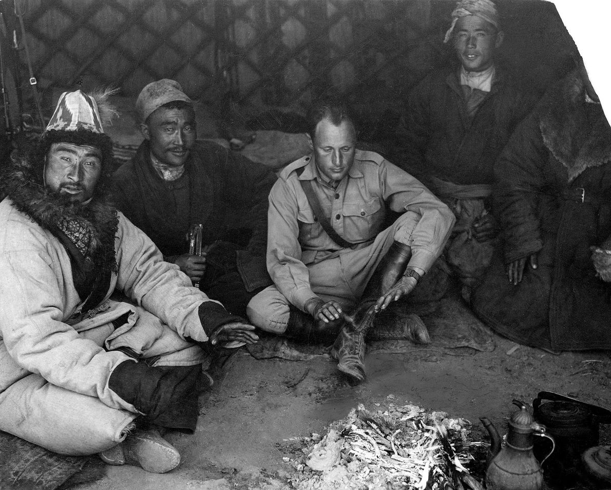 Georges-Marie Haardt spends Christmas Eve, 1930 with his local guides in the Tien Shan Mountains of ...