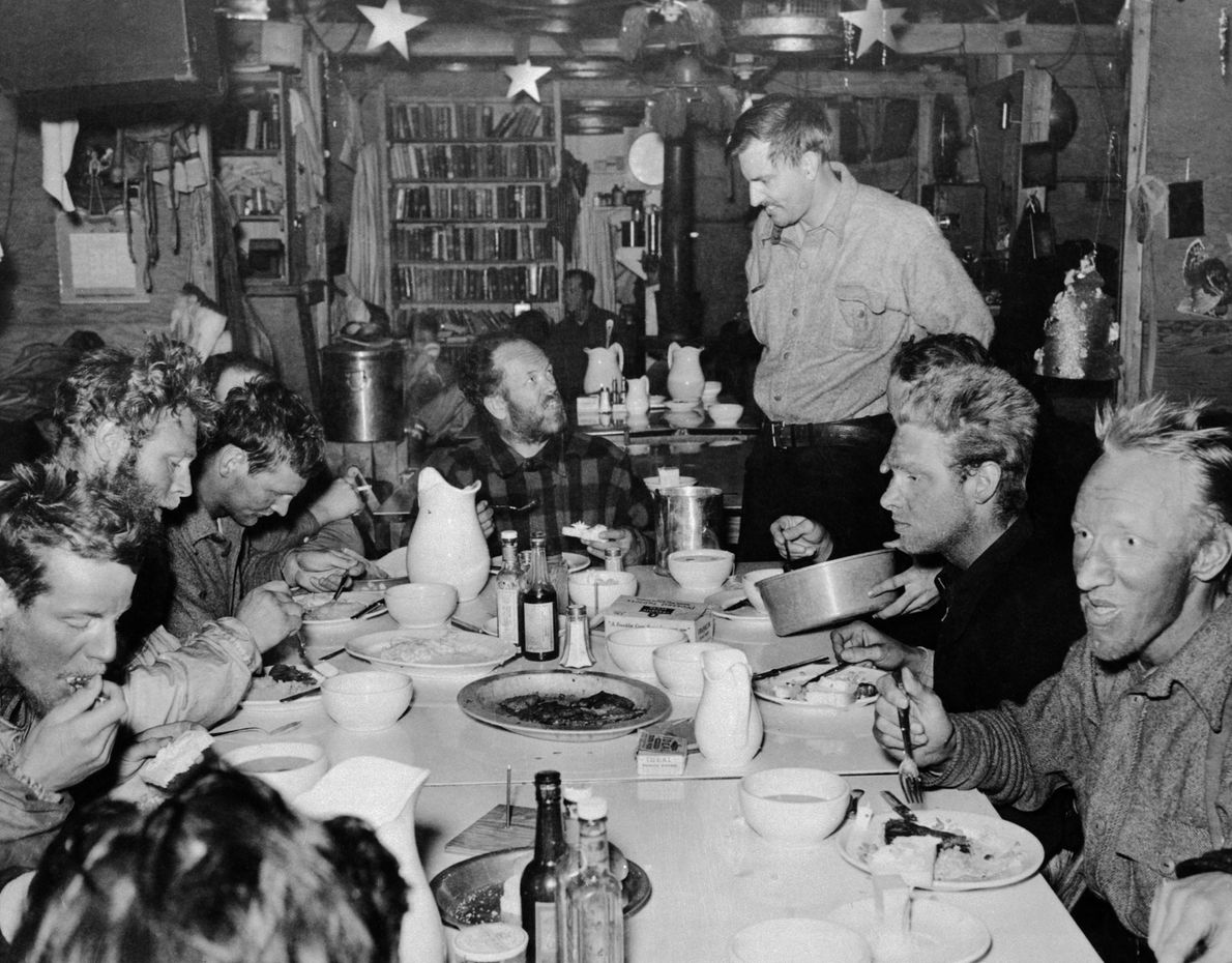 Members of Richard Byrd's Third Antarctic Expedition share a meal on Christmas Day, 1940 at their ...