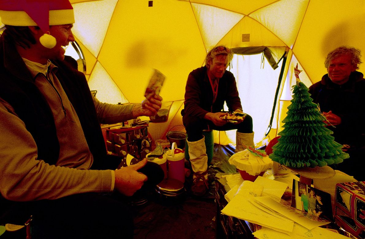 Alex Lowe (left) shares a card from home with members of his climbing team on Christmas ...