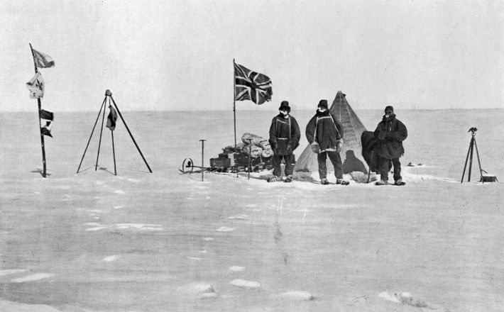 Members of British explorer Earnest Shackleton's Antarctic expedition pose in front of their camp on Christmas ...
