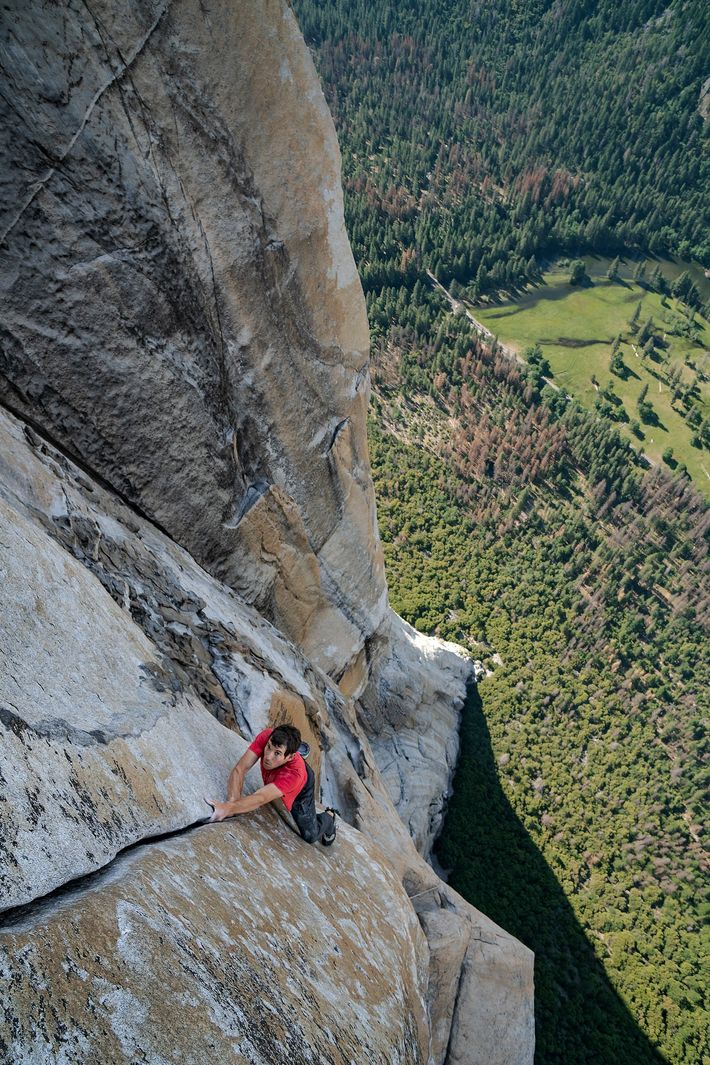 With California's Yosemite Valley far beneath him, Alex Honnold free solos— which means climbing without ropes ...