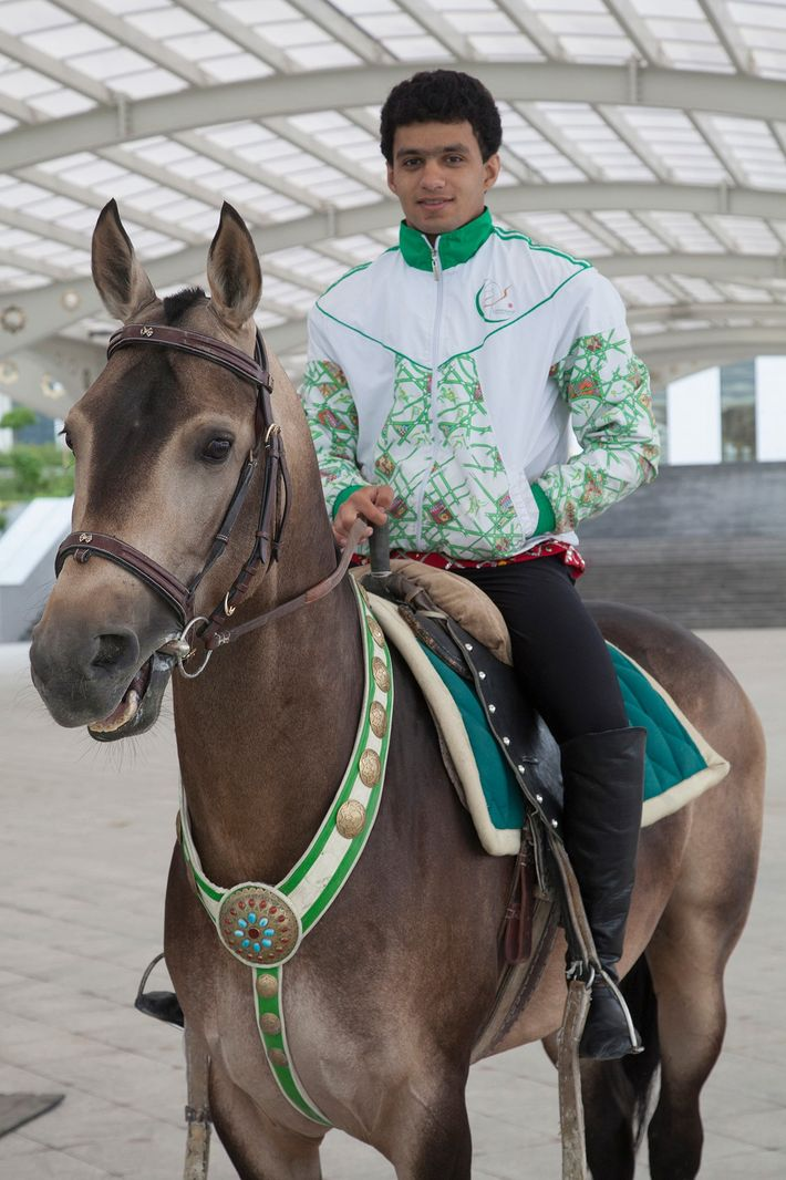 High profile trick riders pose on their horses before a performance at the Ashgabat convention centre.