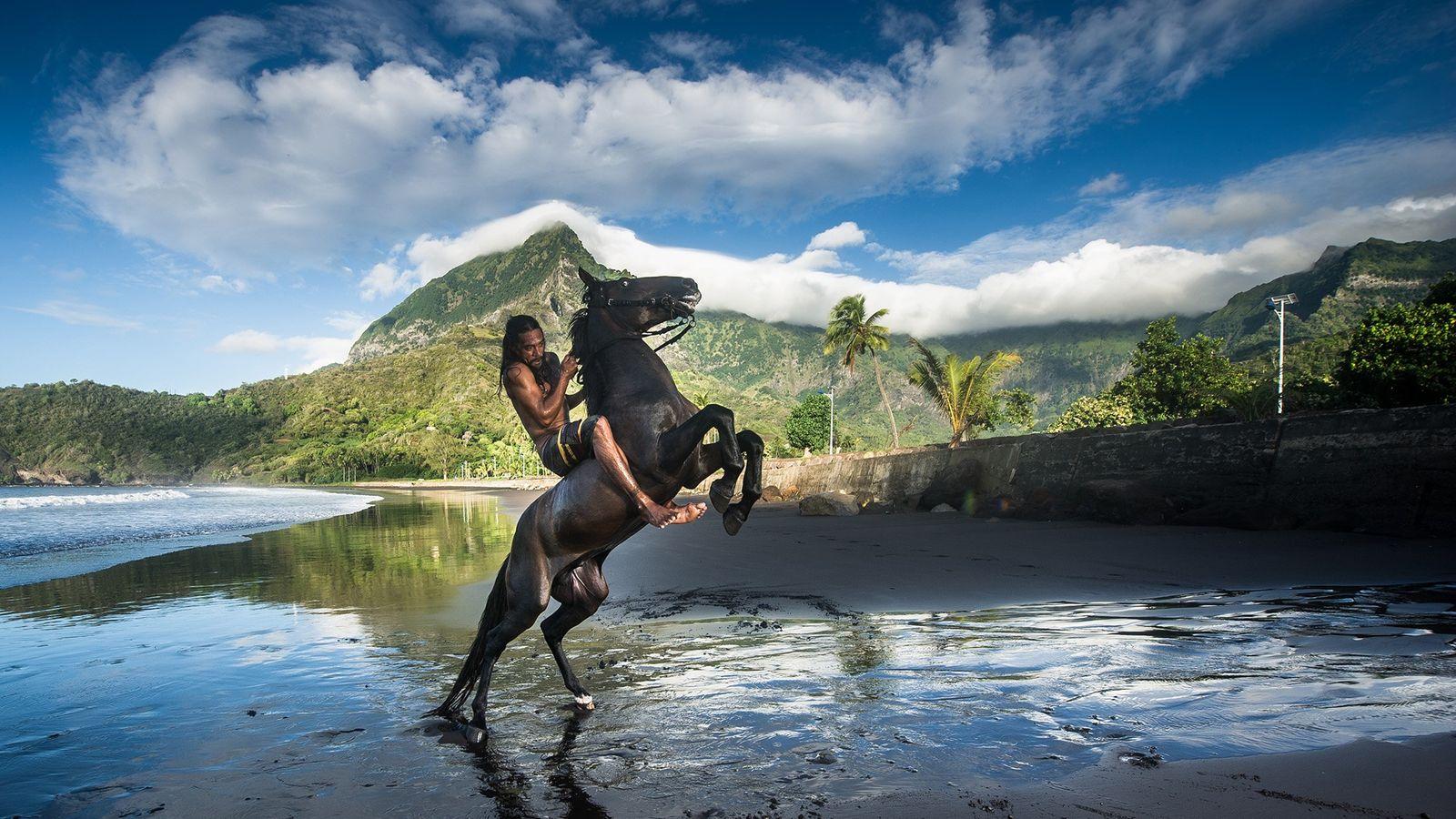 Jérémie Kehuehitu rises and dances with his horses on Hiva Oa's black sand beaches.