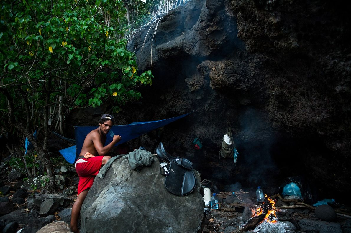 After a day on horseback, riders set up the camp in a small cave. In the ...