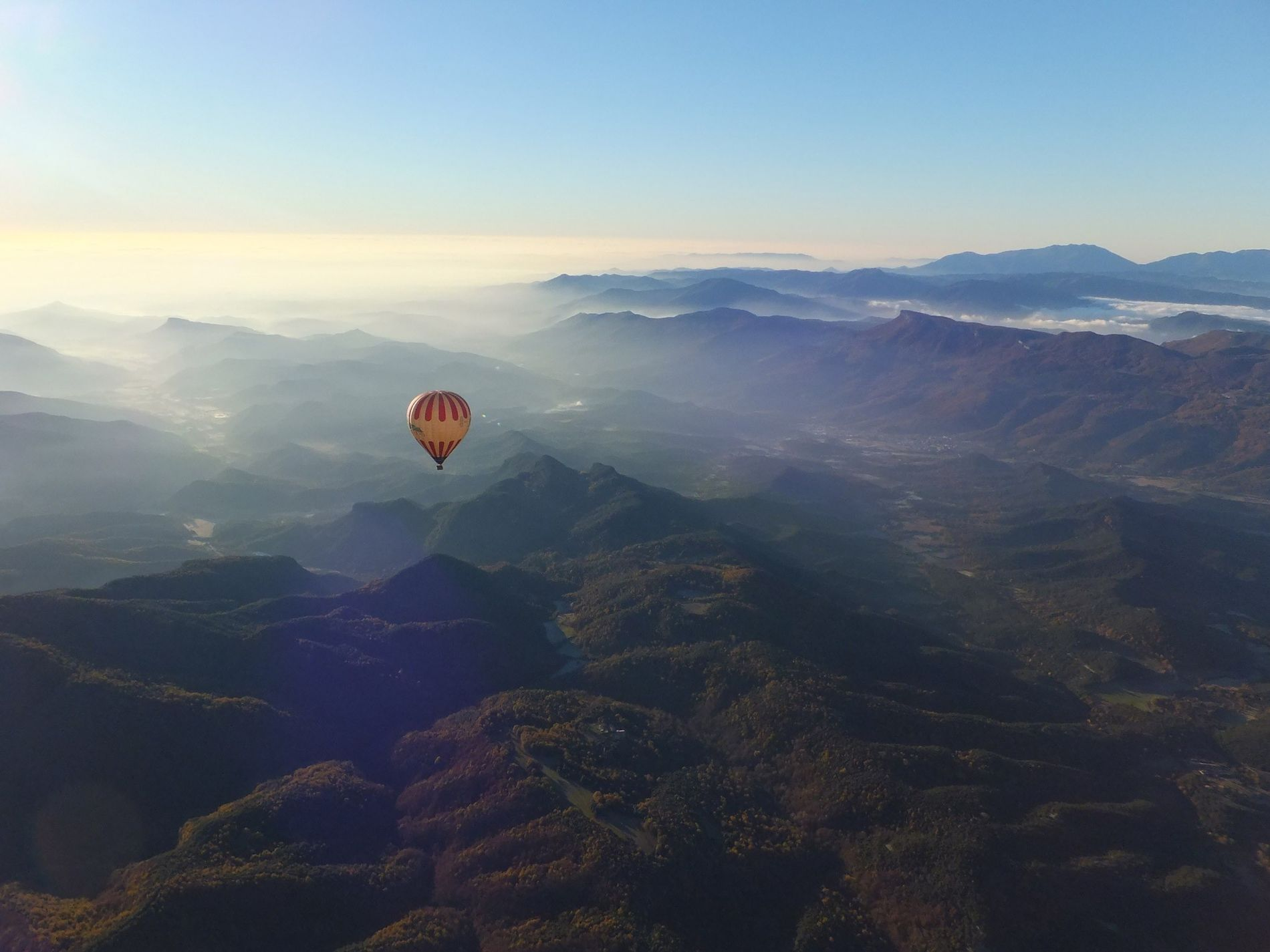Hot-air ballon riders take in the scenic views of Garrotxa Volcanic Natural Park Catalonia.  ...