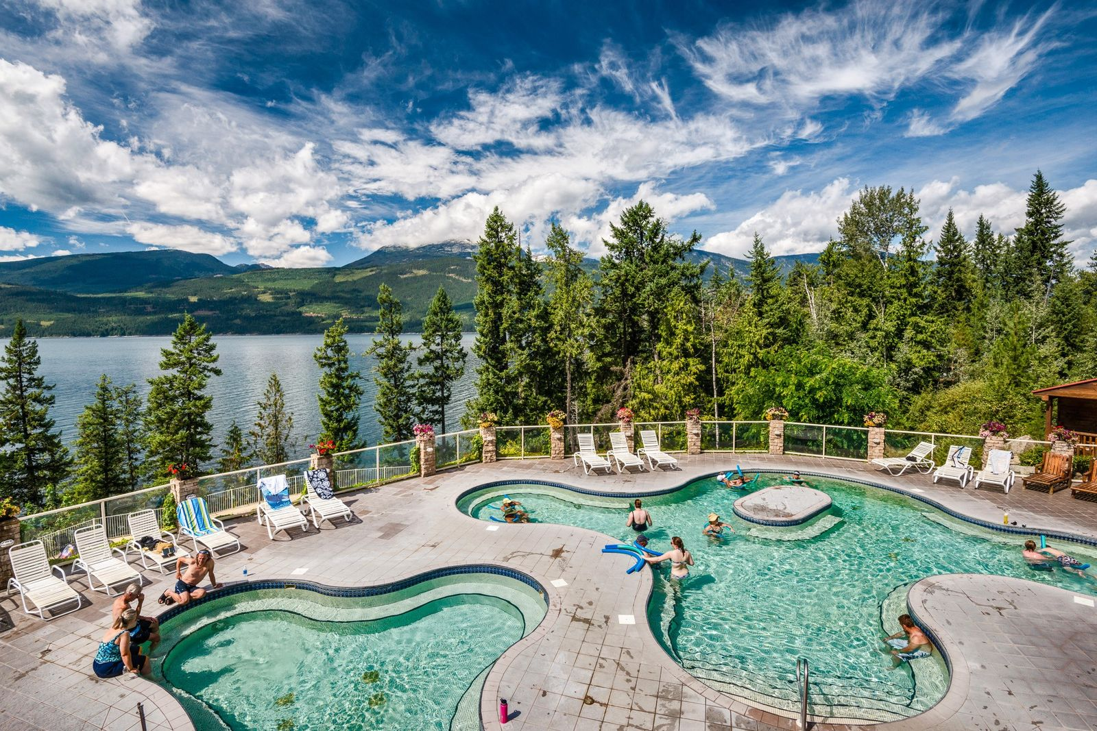 Enjoy a dip at Halcyon Hot Springs Resort and Spa over Upper Arrow Lake, near Nakusp, ...