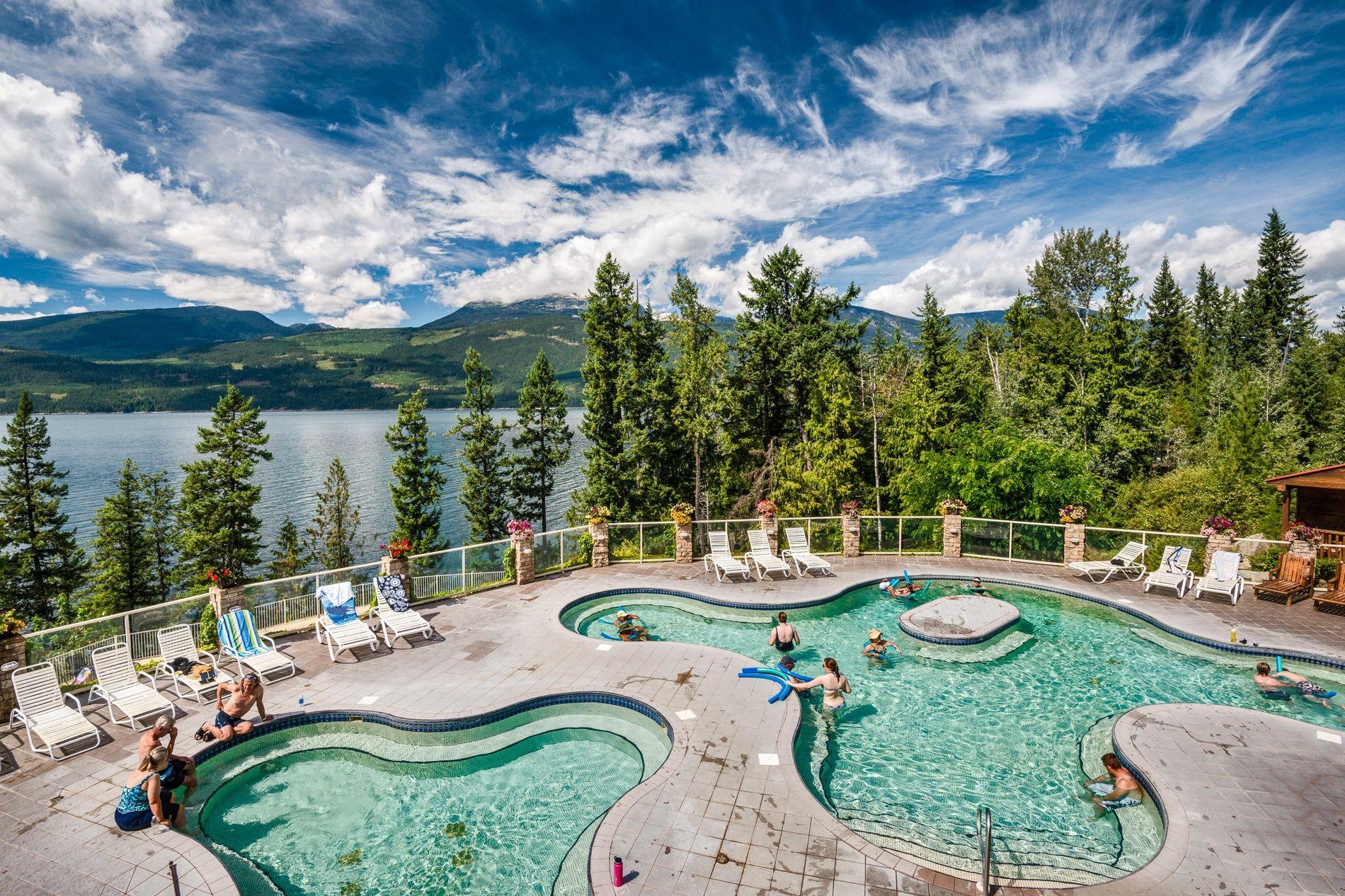 Enjoy a dip at Halcyon Hot Springs Resort and Spa over Upper Arrow Lake, near Nakusp, ...
