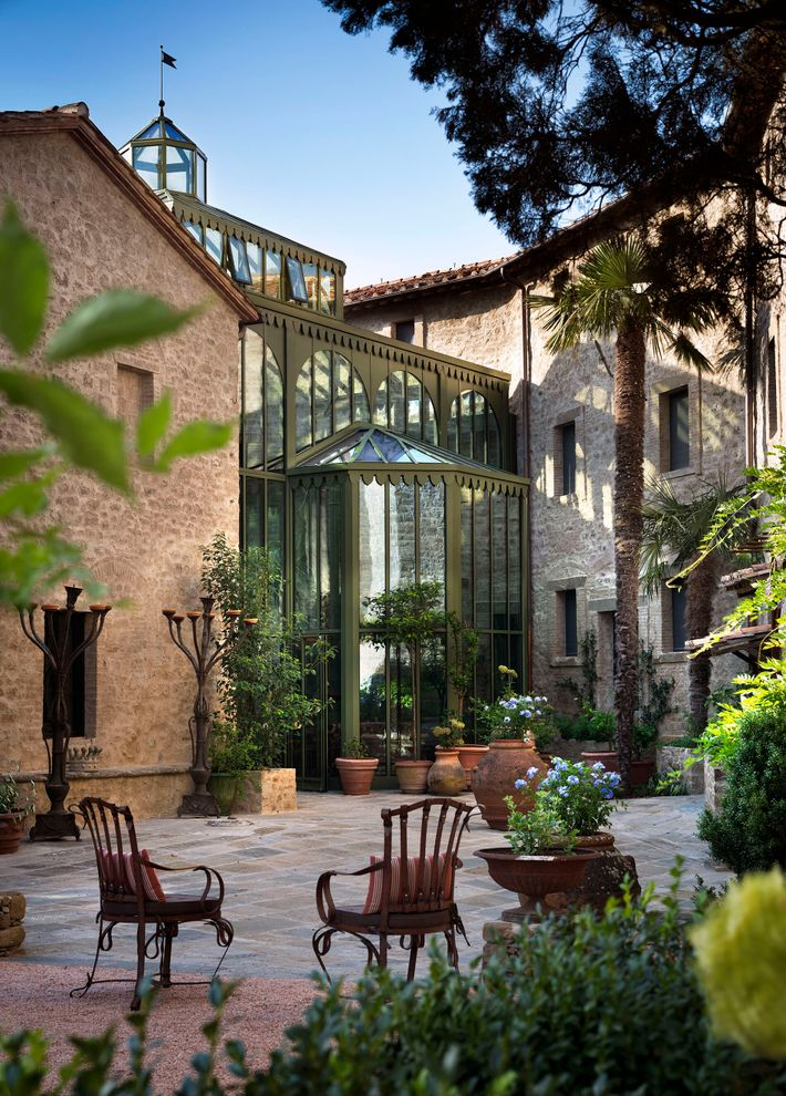 The Palm Court and courtyard at Castello di Reschio, a 1,000-year-old castle transformed into a 36-room ...
