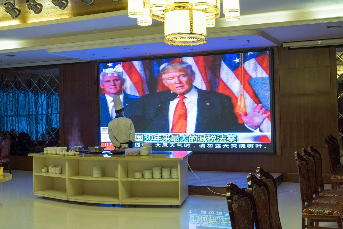 A hotel in the border city of Ji'an, China, broadcasts a speech made by President Trump ...