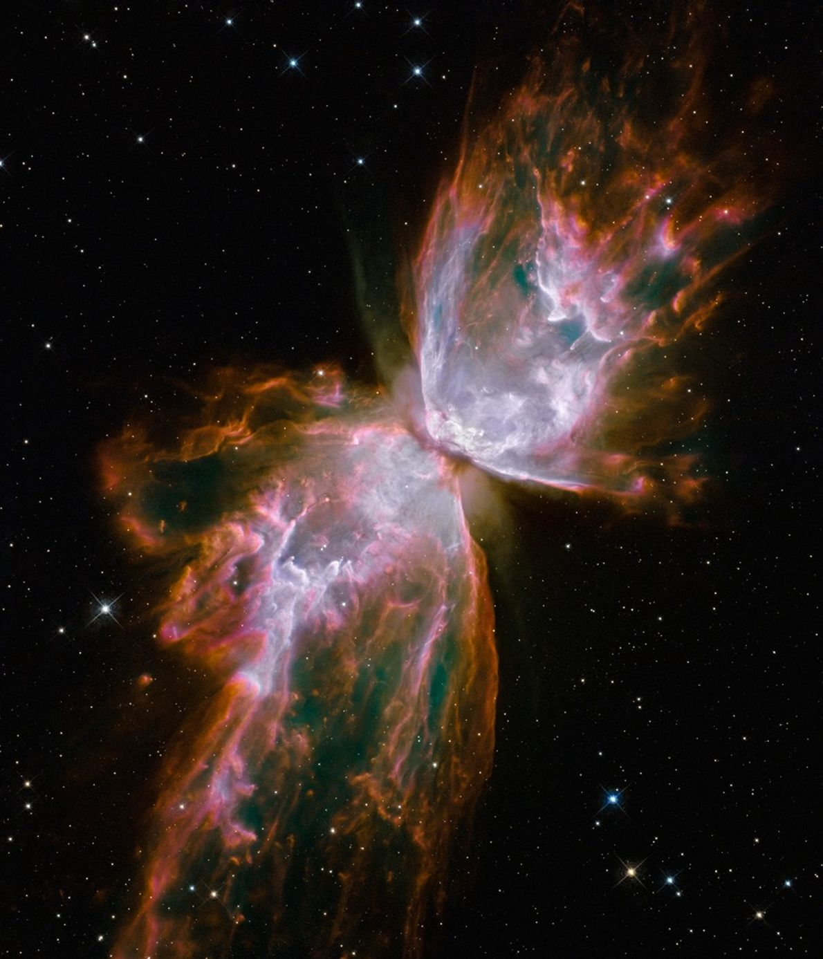 Gas from a dying star resembles a butterfly, its lacy wings formed by the ejection of ...