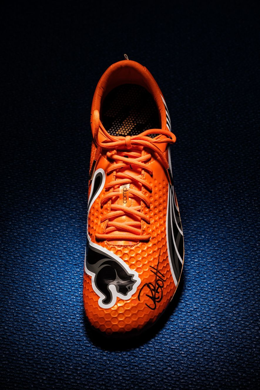A lightweight shoe like the one that Usain Bolt wore to set the world record in ...