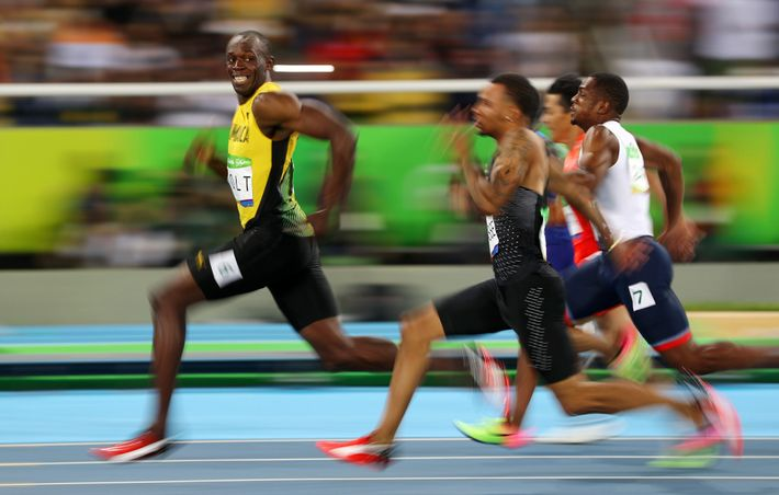 Usain Bolt, shown in 2016, holds the record, 9.58 seconds. With a better running surface and ...