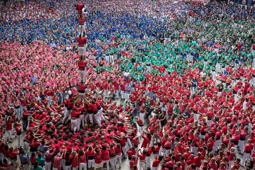 Members of the Castellers de Barcelona build a human tower during the 27th annual Concurs de ...