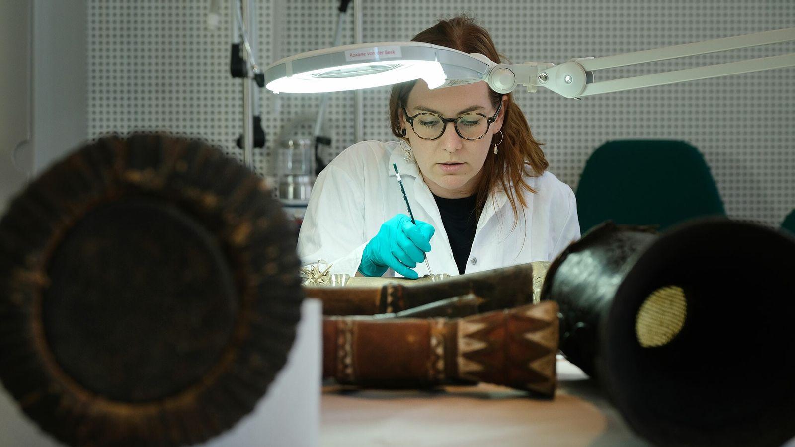 Restorer Roxane Julie von der Beek repairs a drum from Mali at the Ethnological Museum in ...