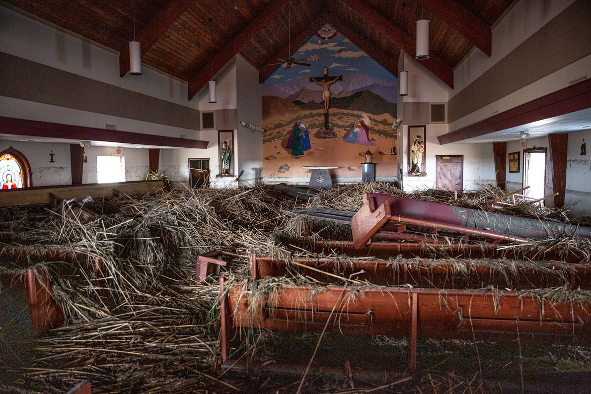 At St. Eugene Catholic Church in Grand Chenier, Louisiana, marsh cane and mud brought inland by ...