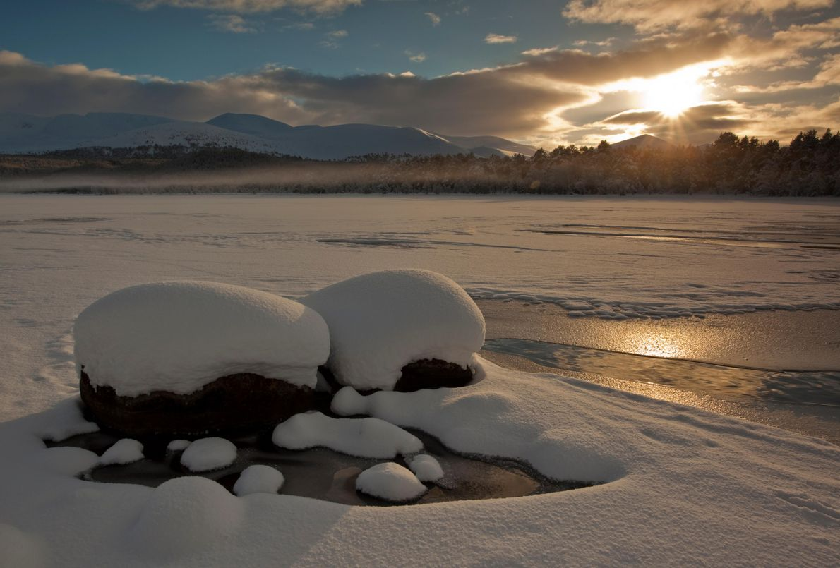 Loch Morlich, frozen over with a thin layer of ice. Easily accessible from the road, the ...