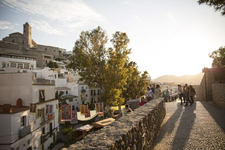 Tourists exploring the streets of Ibiza Town