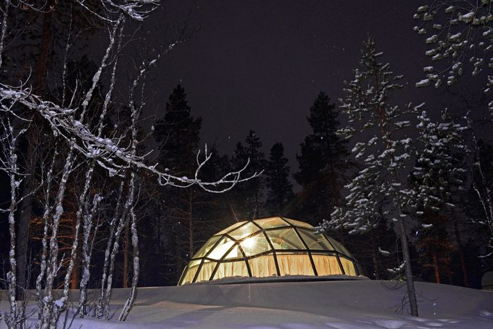Guests get an unobstructed view of the night sky at Kakslauttanen Arctic Resort.