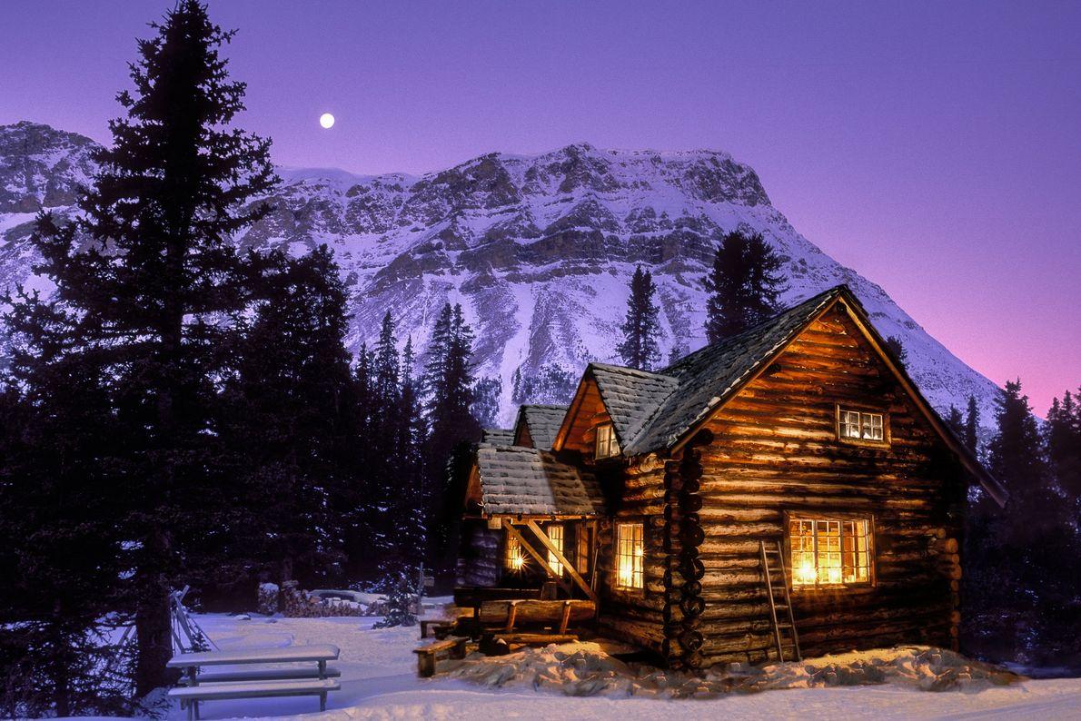 Nightime view of Skoki Lodge cabin in Banff National Park, Alberta.