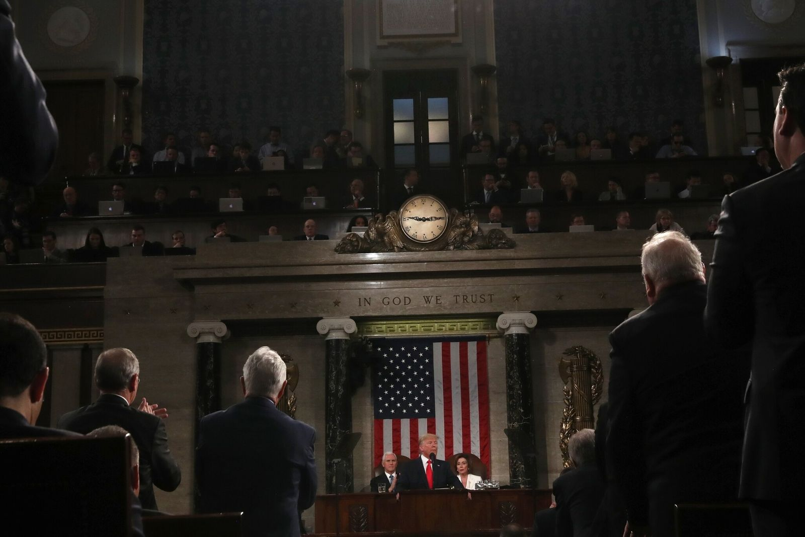 U.S. President Donald Trump, far center, delivers a State of the Union address at the U.S. ...