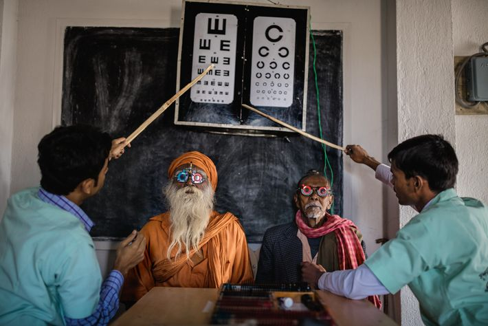 Eye-care workers use test-lens frames to conduct eye exams in India's Sundarbans region. Their goal: to ...