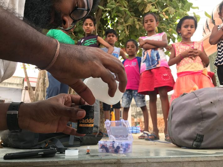 Siddharth Agarwal measures the fluoride level of water from village wells in the Thar Desert.