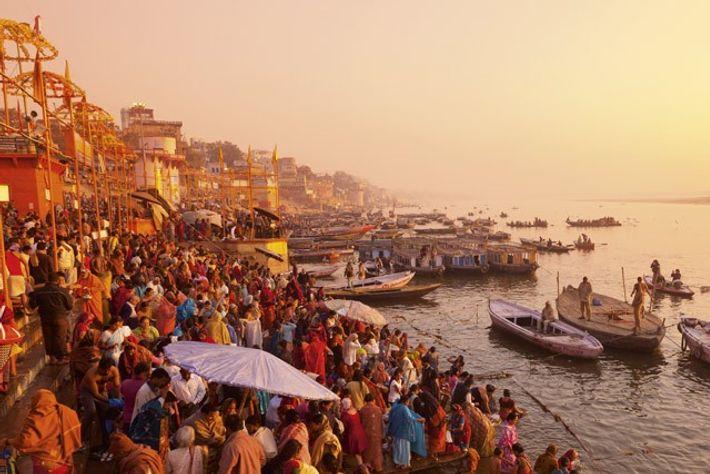 Hindus pray and bathe at the sacred river, Varanasi.