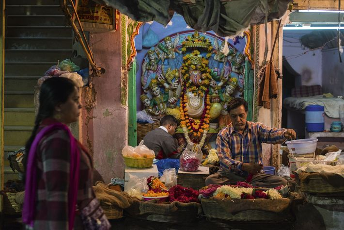 Man at Sardar Market selling flowers to lay as offerings at altar to Ganesh
