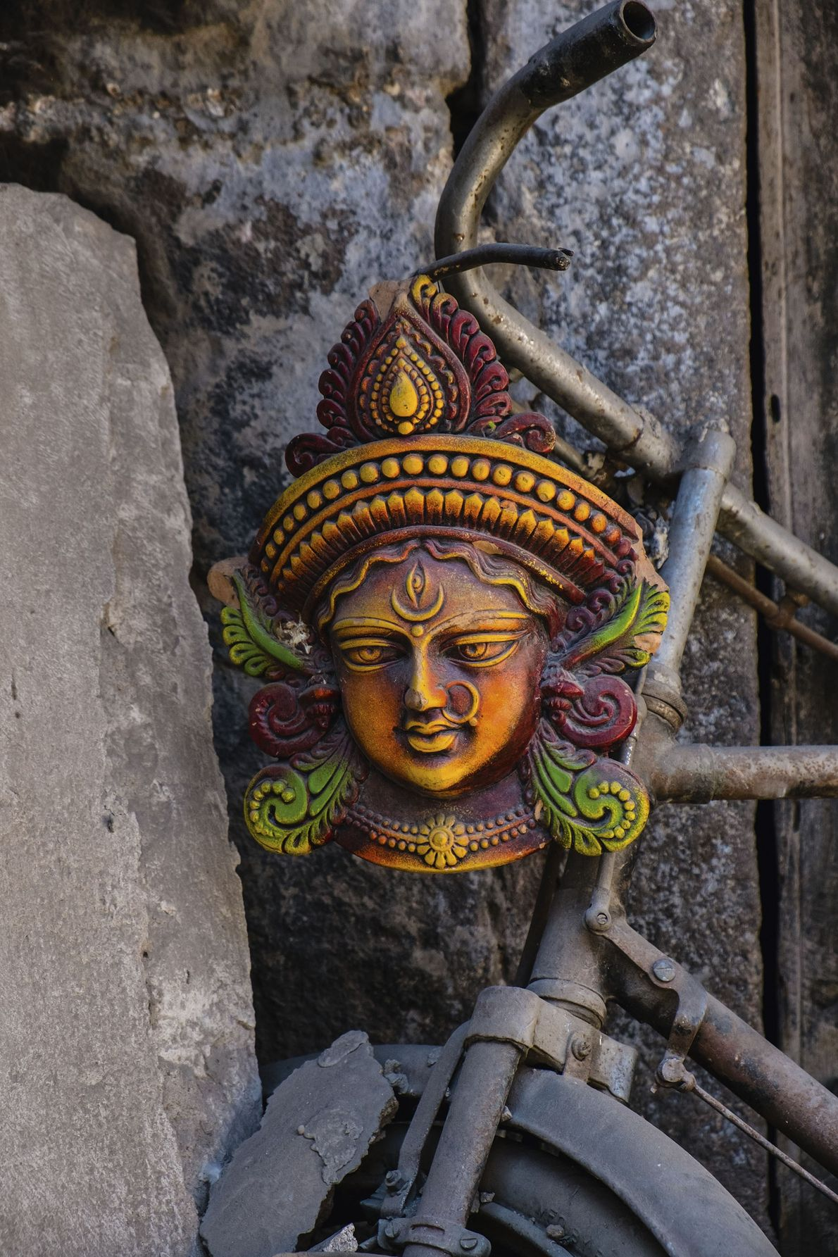 Bust of the Hindu goddess Devi decorating a bicycle.