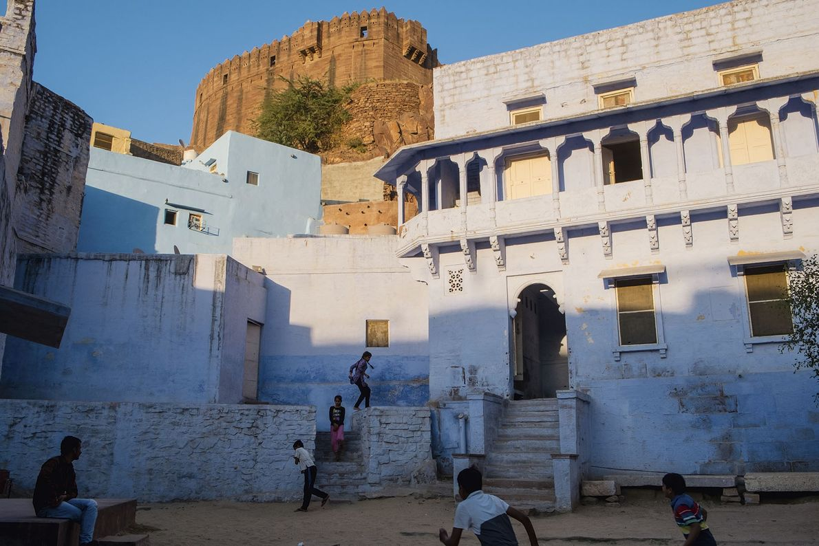 Children playing just below the walls of Mehrangar Fort at sunset