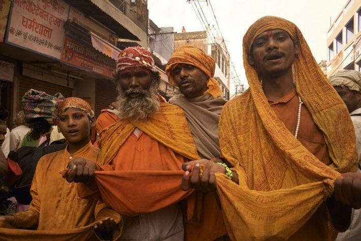 Men collecting alms, Haridwar Kumbh Mela.