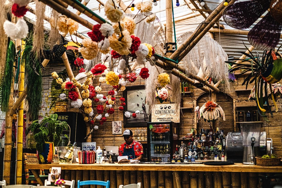 At Helena Adentro, a bar strung with garlands and hanging baskets, the menu celebrates Colombia's varied culinary traditions and highlights the area's ...