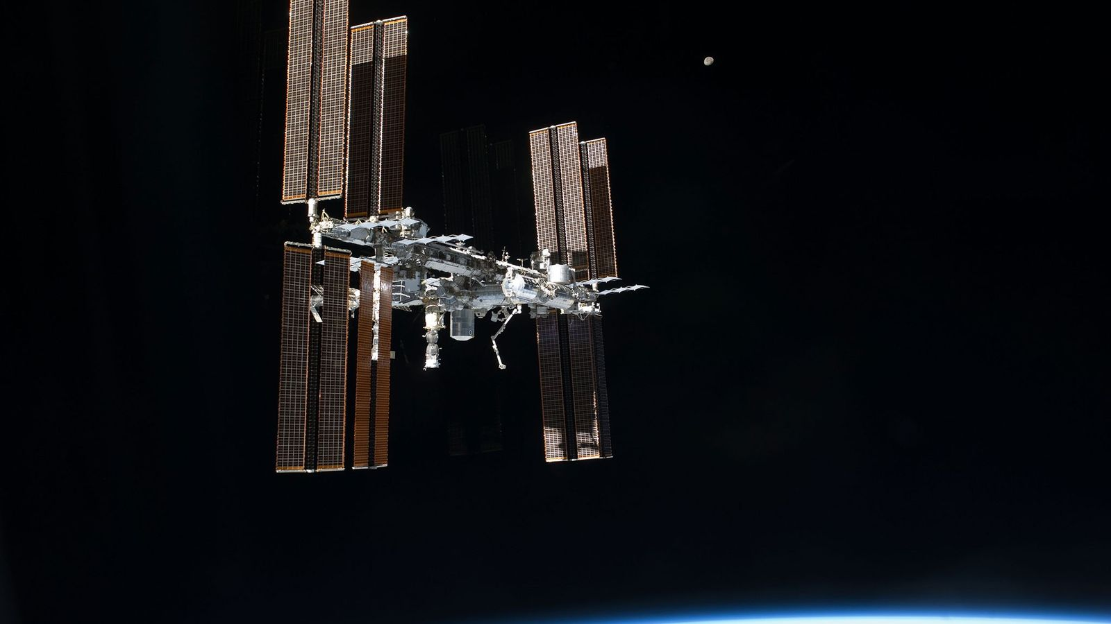 The International Space Station floats above planet Earth.
